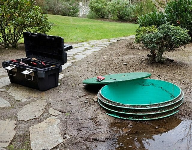septic maintenance with long pipe in yard