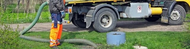 septic services with long pipe in yard truck
